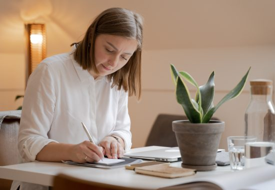 An image of a woman working at a desk